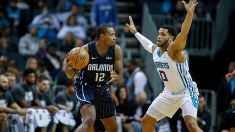 <p>               Orlando Magic forward Gary Clark, left, looks to pass around Charlotte Hornets forward Miles Bridges in the first half of an NBA basketball game in Charlotte, N.C., Monday, Jan. 20, 2020. (AP Photo/Nell Redmond)             </p>