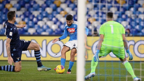 <p>               Lorenzo Insigne of Napoli, centre, scores the first goal of the game against Lazio, during their Italian Cup Serie A quarterfinal soccer match at San Paolo stadium in Napoli, Italy, Tuesday Jan. 21, 2020. (LaPresse via AP)             </p>