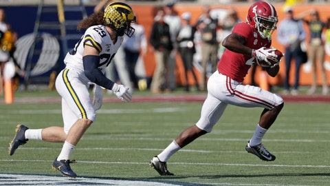 <p>               Alabama wide receiver Jerry Jeudy (4) runs after a reception past Michigan linebacker Jordan Glasgow (29) during the first half of the Citrus Bowl NCAA college football game, Wednesday, Jan. 1, 2020, in Orlando, Fla. (AP Photo/John Raoux)             </p>