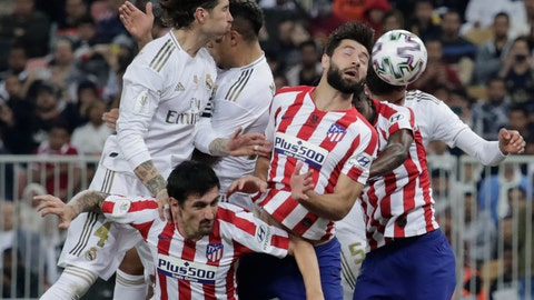 <p>               Atletico Madrid's players and Real Madrid's players jump for the ball during the Spanish Super Cup Final soccer match between Real Madrid and Atletico Madrid at King Abdullah stadium in Jiddah, Saudi Arabia, Sunday, Jan. 12, 2020. (AP Photo/Hassan Ammar)             </p>