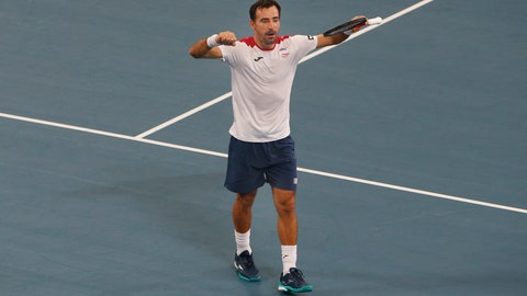 <p>               Ivan Dodig of Croatia reacts to winning the doubles match against Hubert Hurkacz and Lukasz Kubot of Poland during their ATP Cup tennis doubles match in Sydney, Monday, Jan. 6, 2020. (AP Photo/Steve Christo)             </p>