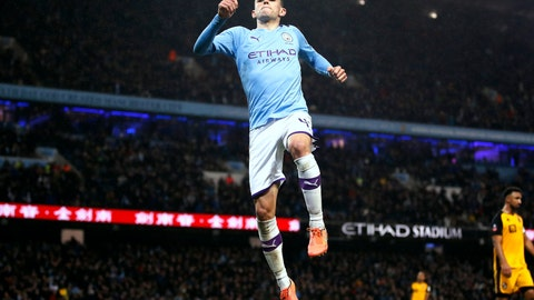 <p>               Manchester City's Phil Foden celebrates scoring his side's fourth goal of the game during the English FA Cup third round soccer match between Manchester City and Port Vale at the Etihad Stadium, Manchester, England, Saturday, Jan. 4, 2020. (Martin Rickett/PA via AP)             </p>