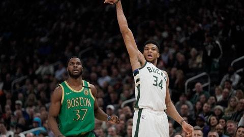 <p>               Milwaukee Bucks' Giannis Antetokounmpo shoots a three-point asket during the first half of an NBA basketball game against the Boston Celtics Thursday, Jan. 16, 2020, in Milwaukee. (AP Photo/Morry Gash)             </p>