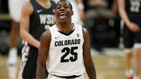 <p>               Colorado guard McKinley Wright IV jokes with teammates as he heads to the bench late in the second half of an NCAA college basketball game against Washington State Thursday, Jan. 23, 2020, in Boulder, Colo. Colorado won 78-56. (AP Photo/David Zalubowski)             </p>