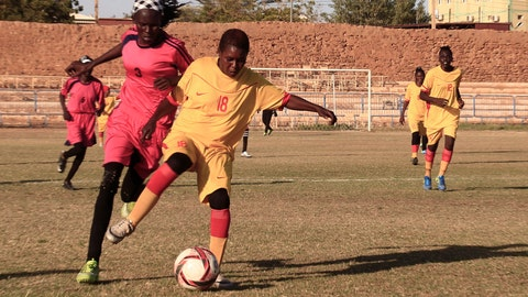<p>               In this Wednesday, Dec. 11, 2019 photo, Sudanese al-Difaa, in pink, and al-Sumood women teams play in Omdurman, Khartoum's twin city, Sudan. The women's soccer league has become a field of contention as Sudan grapples with the transition from three decades of authoritarian rule that espoused a strict interpretation of Islamic Shariah law. (AP Photo)             </p>
