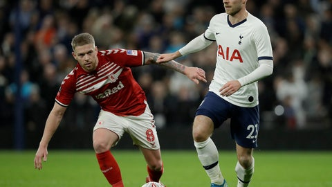 <p>               Middlesbrough's Adam Clayton, left, and Tottenham's Christian Eriksen challenge for the ball during the English FA Cup third round replay soccer match between Tottenham Hotspur and Middlesbrough FC at the Tottenham Hotspur Stadium in London, Tuesday, Jan. 14, 2020.(AP Photo/Matt Dunham)             </p>