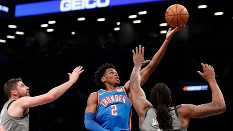 <p>               Oklahoma City Thunder guard Shai Gilgeous-Alexander (2) goes up for two points as Brooklyn Nets guard Joe Harris, left, and Nets center DeAndre Jordan (6) defend the shot during the first half of an NBA basketball game, Tuesday, Jan. 7, 2020, in New York. (AP Photo/Kathy Willens)             </p>