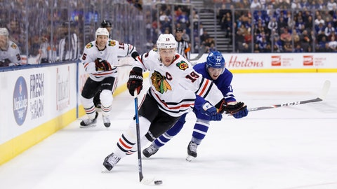 <p>               Chicago Blackhawks centre Jonathan Toews (19) skates with the puck as Toronto Maple Leafs centre Adam Brooks trails during first period NHL hockey action in Toronto, Saturday, Jan. 18, 2020. (Cole Burston/The Canadian Press via AP)             </p>