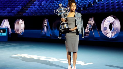 <p>               Defending woman's singles champion Japan's Naomi Osaka holds the Daphne Ackhurst Cup following the official draw ceremony on Margaret Court Arena ahead of the Australian Open tennis championship in Melbourne, Australia, Thursday, Jan. 16, 2020. (AP Photo/Mark Baker)             </p>