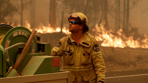 <p>               A Forest Corporation worker manages a fire hose as he battles a fire near Moruya, Australia, Saturday, Jan. 4, 2020. Australia's Prime Minister Scott Morrison called up about 3,000 reservists as the threat of wildfires escalated Saturday in at least three states with two more deaths, and strong winds and high temperatures were forecast to bring flames to populated areas including the suburbs of Sydney. (AP Photo/Rick Rycroft)             </p>