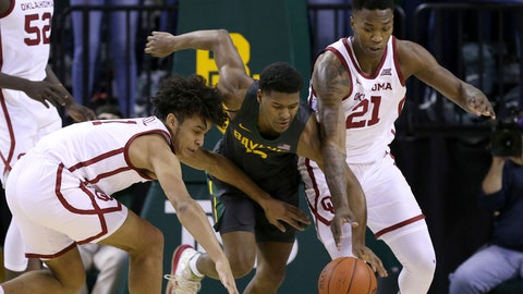<p>               Oklahoma forward Jalen Hill (1) Baylor guard Jared Butler (12) and Oklahoma forward Kristian Doolittle (21) reach for the loose ball in the first half of an NCAA college basketball game Monday, Jan. 20, 2020, in Waco, Texas. (AP photo/ Jerry Larson)             </p>