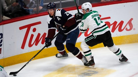 <p>               Colorado Avalanche center Nathan MacKinnon, left, looks to pass the puck as Dallas Stars center Mattias Janmark defends in the first period of an NHL hockey game Tuesday, Jan. 14, 2020, in Denver. (AP Photo/David Zalubowski)             </p>