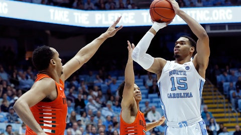 <p>               North Carolina forward Garrison Brooks (15) shoots while Miami center Rodney Miller Jr., left, and guard Isaiah Wong defend during the first half of an NCAA college basketball game in Chapel Hill, N.C., Saturday, Jan. 25, 2020. (AP Photo/Gerry Broome)             </p>