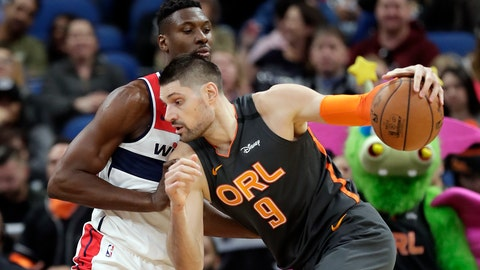 <p>               Orlando Magic center Nikola Vucevic (9) drives to the basket against Washington Wizards center Ian Mahinmi during the first half of an NBA basketball game Wednesday, Jan. 8, 2020, in Orlando, Fla. (AP Photo/John Raoux)             </p>