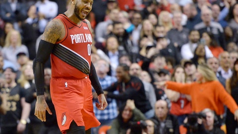 <p>               Portland Trail Blazers forward Carmelo Anthony (00) reacts after sinking a go-ahead basket against the Toronto Raptors during the second half of an NBA basketball game Tuesday, Jan. 7, 2020, in Toronto. (Nathan Denette/The Canadian Press via AP)             </p>