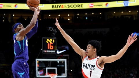 <p>               Charlotte Hornets guard Devonte' Graham, left, shoots the ball over Portland Trail Blazers guard Anfernee Simons, right, during the first half of an NBA basketball game in Portland, Ore., Monday, Jan. 13, 2020. (AP Photo/Steve Dykes)             </p>