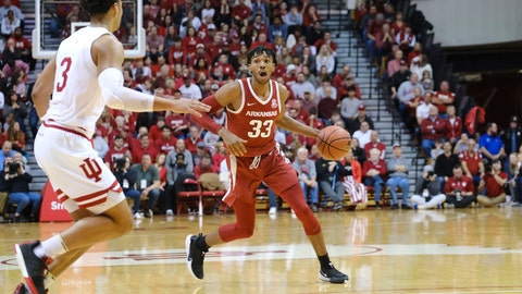 <p>               Arkansas guard Jimmy Whitt Jr. (33) brings the ball upcourt in front of Indiana forward Justin Smith (3) in the second half of an NCAA college basketball game in Bloomington, Ind., Sunday, Dec. 29, 2019. (AP Photo/AJ Mast)             </p>