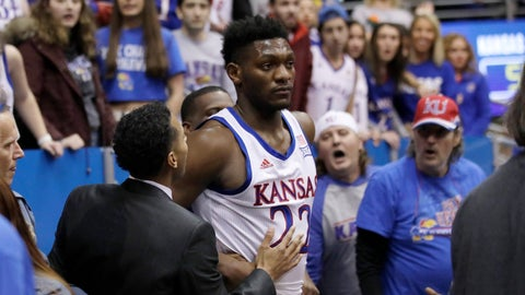 <p>               Kansas forward Silvio De Sousa (22) walks out of the crowd after a brawl during the second half of an NCAA college basketball game against Kansas State in Lawrence, Kan., Tuesday, Jan. 21, 2020. Kansas defeated Kansas State 81-59. (AP Photo/Orlin Wagner)             </p>