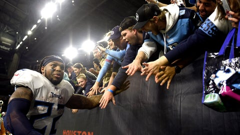 <p>               Tennessee Titans running back Derrick Henry (22) celebrates with fans after an NFL football game against the Houston Texans Sunday, Dec. 29, 2019, in Houston. Henry moved into first place for the season rushing title on a 53-yard touchdown run during the fourth quarter. The Titans won 35-14. (AP Photo/Eric Christian Smith)             </p>