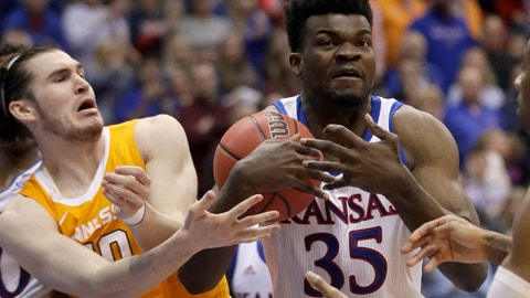 <p>               Kansas center Udoka Azubuike (35) rebounds against Tennessee forward John Fulkerson, left, during the second half of an NCAA college basketball game in Lawrence, Kan., Saturday, Jan. 25, 2020. (AP Photo/Orlin Wagner)             </p>
