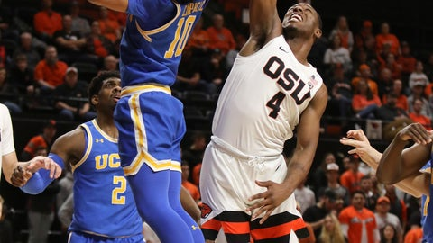 <p>               UCLA's Tyger Campbell (10) blocks a basket by Oregon State's Alfred Hollins (4) during the first half of an NCAA college basketball game in Corvallis, Ore., Thursday, Jan. 23, 2020. (AP Photo/Amanda Loman)             </p>