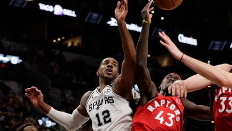 <p>               San Antonio Spurs forward LaMarcus Aldridge (12) and Toronto Raptors forward Pascal Siakam (43) scramble for a rebound during the second half of an NBA basketball game in San Antonio, Sunday, Jan. 26, 2020. (AP Photo/Eric Gay)             </p>