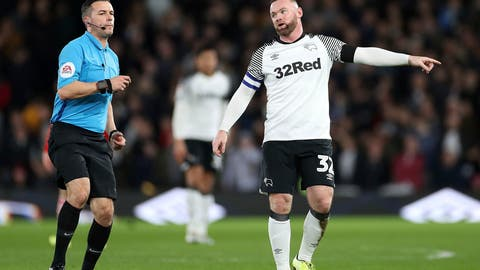 <p>               Derby County's Wayne Rooney talks with referee Dean Whitestone during the game against Barnsley, during their English Championship soccer match at Pride Park in Derby, England, Thursday Jan. 2, 2020. (Bradley Collyer/PA via AP)             </p>