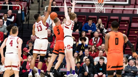 <p>               Oregon State forward Tres Tinkle (3) shoots as Stanford forward Oscar da Silva (13) and James Keefe (22) defend during the first half of an NCAA college basketball game Thursday, Jan. 30, 2020, in Stanford, Calif. (AP Photo/John Hefti)             </p>