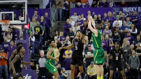 <p>               Oregon guard Payton Pritchard, right, shoots the game-winning 3-point basket as Washington guard Jamal Bey (5) tries for the block during overtime in an NCAA college basketball game, Saturday, Jan. 18, 2020, in Seattle. Oregon won 64-61 in overtime. (AP Photo/Ted S. Warren)             </p>