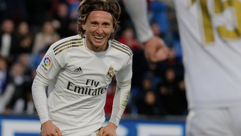 <p>               Real Madrid's Luka Modric, left, celebrates with teammate Federico Valverde after scoring his side's third goal during a Spanish La Liga soccer match between Getafe and Real Madrid at the Coliseum Alfonso Perez stadium in Getafe, Spain, Saturday, Jan. 4, 2020. (AP Photo/Paul White)             </p>