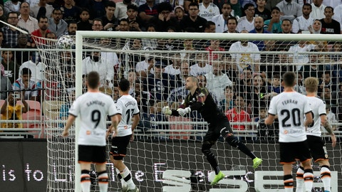 <p>               Valencia's goalkeeper Jasper Cillessen, center, fails to stop the opening goal from Real Madrid's Toni Kroos during the Spanish Super Cup semifinal soccer match between Real Madrid and Valencia at King Abdullah stadium in Jiddah, Saudi Arabia, Wednesday, Jan. 8, 2020. (AP Photo/Hassan Ammar)             </p>