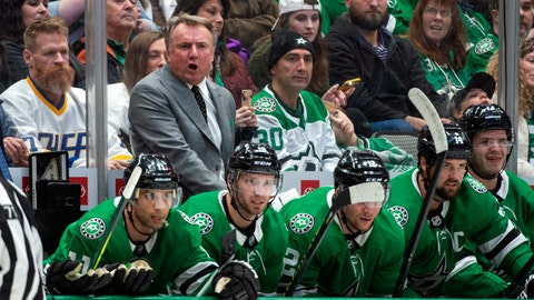"<p>               Dallas Stars interim head coach Rick Bowness yells to his players in the first period of an NHL hockey game against the New Jersey Devils, Tuesday, Dec. 10, 2019, in Dallas. Bowness was announced as interim head coach earlier in the day after former head coach Jim Montgomery was fired for ""unprofessional conduct."" (AP Photo/Jeffrey McWhorter)             </p>"