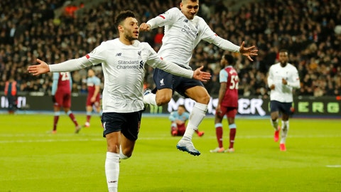 <p>               Liverpool's Alex Oxlade-Chamberlain, left, celebrates with Liverpool's Roberto Firmino after scoring his side's second goal during the English Premier League soccer match between West Ham Utd and Liverpool at the London Stadium in London, Wednesday, Jan. 29, 2020. (AP Photo/Frank Augstein)             </p>