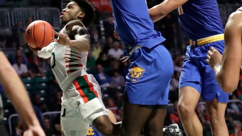 <p>               Miami guard Chris Lykes, left, goes to the basket as Pittsburgh forward Eric Hamilton, center, and guard Justin Champagnie, right, defend during the second half of an NCAA college basketball game, Sunday, Jan. 12, 2020, in Coral Gables, Fla. Miami won 66-58. (AP Photo/Lynne Sladky)             </p>