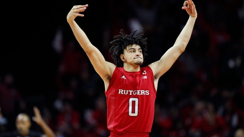 <p>               Rutgers guard Geo Baker (0) celebrates after hitting a three-point shot during the first half of an NCAA college basketball game against Seton Hall, Saturday, Dec. 14, 2019, in Piscataway, N.J. (AP Photo/Kathy Willens)             </p>