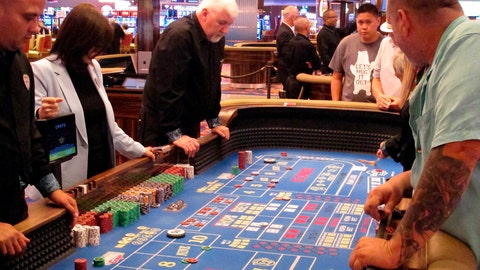 <p>               In this June 20, 2019 photo, players gather around a table for a game of craps at the Hard Rock casino in Atlantic City N.J. New Jersey's casinos won nearly $3.3 billion from gamblers in 2019, the first time since 2012 that the Atlantic City gambling halls had won more than $3 billion, according to figures released Tuesday, Jan. 14, 2020, by the New Jersey Division of Gaming Enforcement.  (AP Photo/Wayne Parry)             </p>