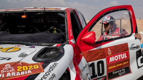 <p>               Driver Fernando Alonso, of Spain, walks into his Toyota at the end of stage ten of the Dakar Rally between Haradth and Shubaytah, Saudi Arabia, Wednesday, Jan. 15, 2020. (AP Photo/Bernat Armangue)             </p>