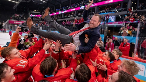 <p>               In this photo provided by the IOC, Russia team coach Vladimir Filatov is lifted as his team celebrates defeating the USA in the final of the men's ice hockey competition at the 2020 Winter Youth Olympic Games in Lausanne, Switzerland, Wednesday, Jan. 22, 2022. (Joel Marklund for OIS via AP)             </p>
