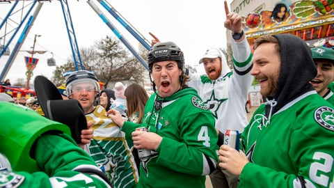 <p>               Dallas Stars fans get hyped in the midway outside the Cotton Bowl before the NHL Winter Classic hockey game between the Dallas Stars and the Nashville Predators, Wednesday, Jan. 1, 2020, in Dallas. (AP Photo/Jeffrey McWhorter)             </p>