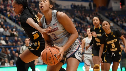 <p>               Connecticut's Megan Walker looks to shoot as Wichita State's Shyia Smith, left, defends during the second half of an NCAA college basketball game Thursday, Jan. 2, 2020, in Hartford, Conn. (AP Photo/Jessica Hill)             </p>