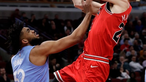 <p>               Chicago Bulls forward Lauri Markkanen, right, drives to the basket against Minnesota Timberwolves center Karl-Anthony Towns during the second half of an NBA basketball game in Chicago, Wednesday, Jan. 22, 2020. The Bulls won 117-110.(AP Photo/Nam Y. Huh)             </p>