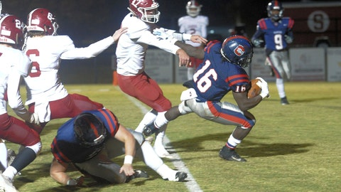 <p>               In this photo provided by Mike Pettus, Central of Clay County High School's Quentin Knight (16) scores against Sardis High School during a football game in Lineville, Ala., Friday, Nov. 8, 2019. At Central of Clay County High School in Alabama, small-town football is thriving. The team has helped bond two communities that were once fierce rivals, then reluctant partners, and now proud supporters of a two-time Class 5A state football champions. (Mike Pettus via AP)             </p>