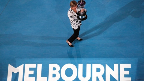 <p>               Former Australian Open champion Margaret Court holds up the women's Australian Open trophy, the Daphne Ackhurst Memorial Cup, as her 50th anniversary of her Grand Slam is celebrated at the Australian Open tennis championship in Melbourne, Australia, Monday, Jan. 27, 2020. (AP Photo/Andy Wong)             </p>