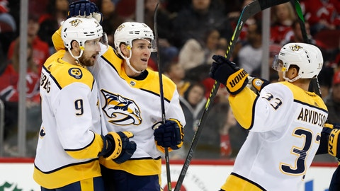 <p>               Nashville Predators center Kyle Turris (8) celebrates with left wing Filip Forsberg (9), of Sweden, as right wing Viktor Arvidsson (33), also of Sweden, joins the group after Forsberg scored a goal during the first period of an NHL hockey game against the New Jersey Devils, Thursday, Jan. 30, 2020, in Newark, N.J. (AP Photo/Kathy Willens)             </p>
