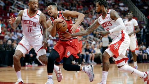 <p>               Portland Trail Blazers guard CJ McCollum, middle, drives to the basket between Houston Rockets forward PJ Tucker (17) and guard Ben McLemore, right, during the first half of an NBA basketball game Wednesday, Jan. 15, 2020, in Houston. (AP Photo/Michael Wyke)             </p>