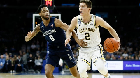 <p>               Villanova's Collin Gillespie, right, tries to dribble past Georgetown's Jahvon Blair during the first half of an NCAA college basketball game, Saturday, Jan. 11, 2020, in Philadelphia. (AP Photo/Matt Slocum)             </p>