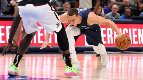 <p>               Dallas Mavericks forward Dwight Powell (7) stumbles due to injury in the first half of an NBA basketball game against the Los Angeles Clippers Tuesday, Jan. 21, 2020 in Dallas. (AP Photo/Richard W. Rodriguez)             </p>