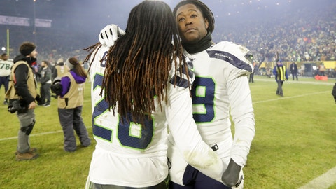 <p>               Seattle Seahawks' Shaquem Griffin and Shaquill Griffin embrace after an NFL divisional playoff football game against the Green Bay Packers Sunday, Jan. 12, 2020, in Green Bay, Wis. The Packers won 28-23 to advance to the NFC Championship. (AP Photo/Darron Cummings)             </p>