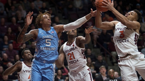 <p>               Virginia Tech guard Wabissa Bede (3) controls the rebound in front of North Carolina forward Armando Bacot (5) during the first half of an NCAA college basketball game in Blacksburg, Va., Wednesday, Jan. 22, 2020.(AP Photo/Lee Luther Jr.)             </p>