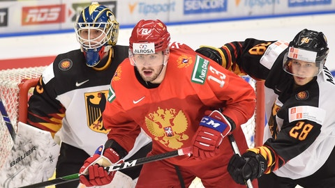 <p>               Goalkeeper Tobias Ancicka, left, and Eric Mik, right, of Germany and Yegor Sokolov of Russia during the 2020 IIHF World Junior Ice Hockey Championships Group B match between Russia and Germany in Ostrava, Czech Republic, on Tuesday Dec. 31, 2019. (Jaroslav Ozana/CTK via AP)             </p>